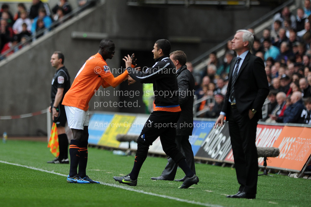 Newcastle's Papiss Cisse (l) celebrates after he scores the opening goal as manager Alan Pardew looks on. . Barclays Premier league,  Swansea city v Newcastle Utd at the Liberty  stadium in Swansea, South Wales on Friday 6th April  2012.  pic by Andrew Orchard, Andrew Orchard sports photography,