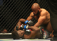Pope Djembo (Red) holds Regis Muyambo (Blue) down during the third bout of the Extreme Fighting Championships, EFC 52 held at the Grand West Casino in Cape Town, South Africa on the 5th August 2016<br /> <br /> Photo by:   Shaun Roy / Real Time Images