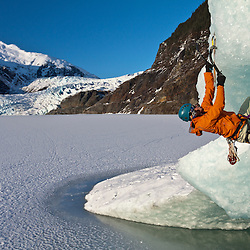Tom Lanagan warming up for the alpine while ice climbing glacial ice bergs near the Mendenhall Glacier, Juneau Alaska