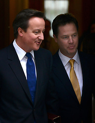 © Licensed to London News Pictures. 08/05/2012. Westminster, UK British Prime Minister David Cameron and Deputy Prime Minister Nick Clegg leave Downing Street. Ministers on Downing Street today 8th May 2012. Photo credit : Stephen Simpson/LNP