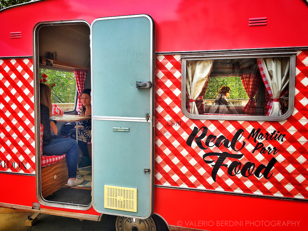 Martin Parr Real Food Van installation at photo London 2016.<br /> British photographer and magnum photos president Martin Parr installed this colourful campervan at Somerset House in London to present his latest book, Real Food.
