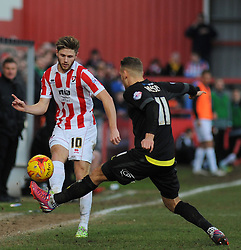 Cheltenham Town's Wes Burns attempts a cross against Bury's Chris Hussey - Photo mandatory by-line: Nizaam Jones - Mobile: 07966 386802 - 14/02/2015 - SPORT - Football - Cheltenham - Whaddon Road - Cheltenham Town v Bury - Sky Bet League Two
