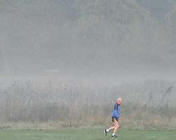 © Licensed to London News Pictures 20/10/2018<br /> SIDCUP,UK.<br /> A runner making an early fitness start to the day.<br /> A cold autumnal mist at Footscray Meadows this morning in Sidcup.<br /> Photo credit: Grant Falvey/LNP