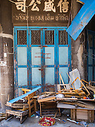 26 FEBRUARY 2016 - BANGKOK, THAILAND: Garbage left be evicted tenants in front of an abandoned shophouse in Verng Nakorn Kasem neighborhood. Verng Nakorn Kasem, also known as the Thieves' Market, was one of Bangkok's most famous shopping districts. It is located on the north edge of Bangkok's Chinatown district, it grew into Bangkok's district for buying and selling musical instruments. The family that owned the land recently sold it and the new owners want to redevelop the famous area and turn it into a shopping mall. The new owners have started evicting existing lease holders and many of the shops have closed. The remaining shops expect to be evicted by the end of 2016.      PHOTO BY JACK KURTZ