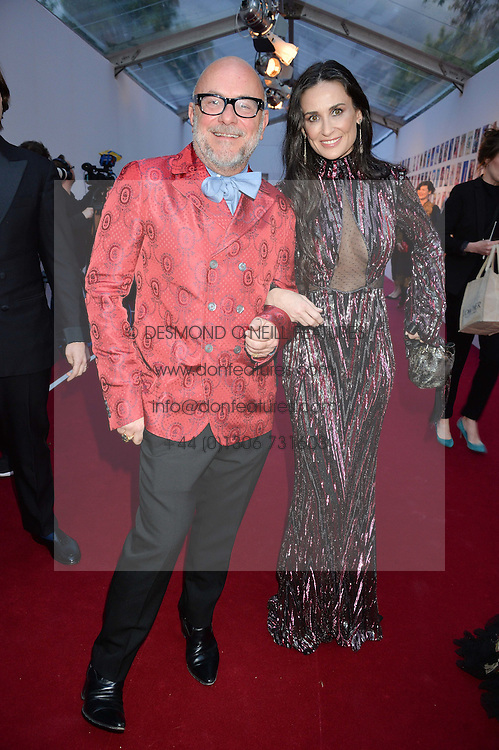 ERIC BUTERBAUGH and DEMI MOORE at British Vogue's Centenary Gala Dinner in Kensington Gardens, London on 23rd May 2016.