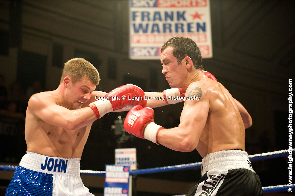 John Wayne (blue/white shorts) Hibbert defeats Kevin McCauley at York Hall, Bethnal Green 9th ocotber 2009. Frank Warren Promotions.Credit: ©Leigh Dawney Photography