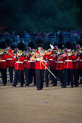 © Licensed to London News Pictures. 12/06/2013. London, UK. Musicians of the Household Division perform during the annual Beating Retreat parade at Horse Guards Parade in London. On two successive evenings each year in June a pageant of military music, precision marching and colour takes place on Horse Guards Parade in the heart of London when the Massed Bands of the Household Division carry out the Ceremony of Beating Retreat. 300 musicians, drummers and pipers perform this age-old ceremony. The Retreat has origins in the early days of chivalry when beating or sounding retreat pulled a halt to the days fighting. Photo credit: Matt Cetti-Roberts/LNP