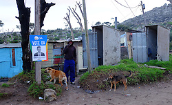 supporters of the Democratic Alliance party celebrate as they seek voters to support their party at the Red Hill informal settlement near Simon's Town, Cape Town during the 2016 local government elections held across South Africa on the 3rd August 2016<br /> <br /> Photo by: Ron Gaunt / RealTime Images