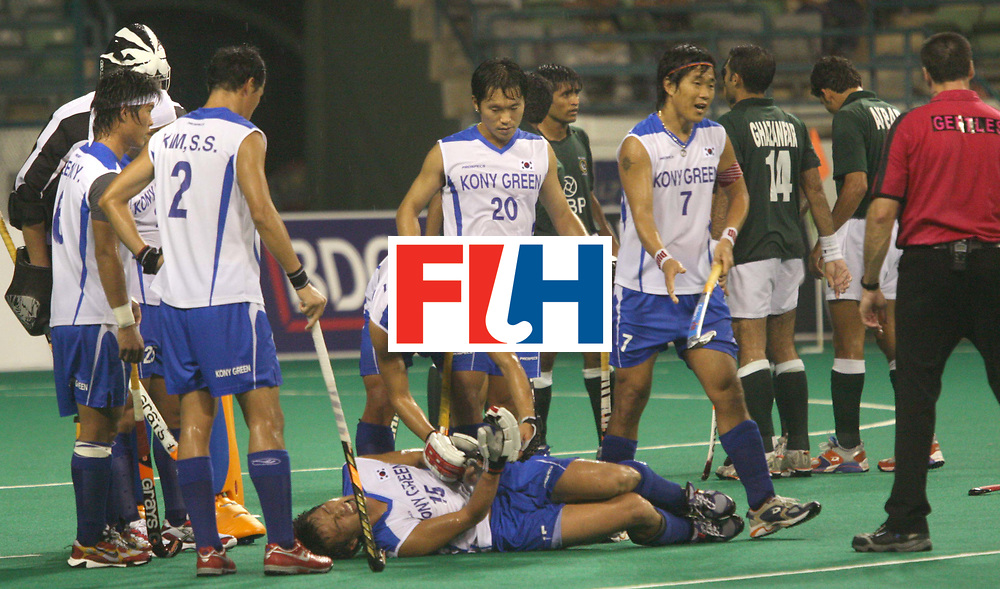 Kuala Lumpur : Korea's Jong Bok Cha was injured during the match against Pakistan in the Samsung Hockey Men Champions Trophy on 06 Dec 2007. Pakistan drew with Korea 3-3. Photo:GNN/Vino John