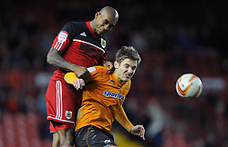Bristol City's Marvin Elliott battles for the high ball with Wolverhampton Wanderers Kevin Doyle - Photo mandatory by-line: Joe Meredith/JMP  - Tel: Mobile:07966 386802 01/12/2012 - Bristol City v Wolves - SPORT - FOOTBALL - Championship -  Bristol  - Ashton Gate Stadium -