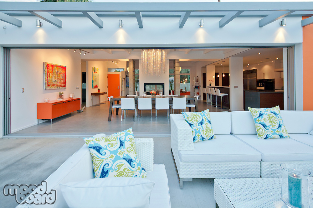 Outdoor seating furniture in patio of luxury mansion
