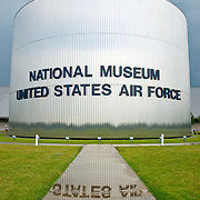 Front entrance of the National Museum of the United States Air Force at Wright-Patterson Air Force Base near Dayton, Ohio. Reflection of text in a puddle after a rain storm.