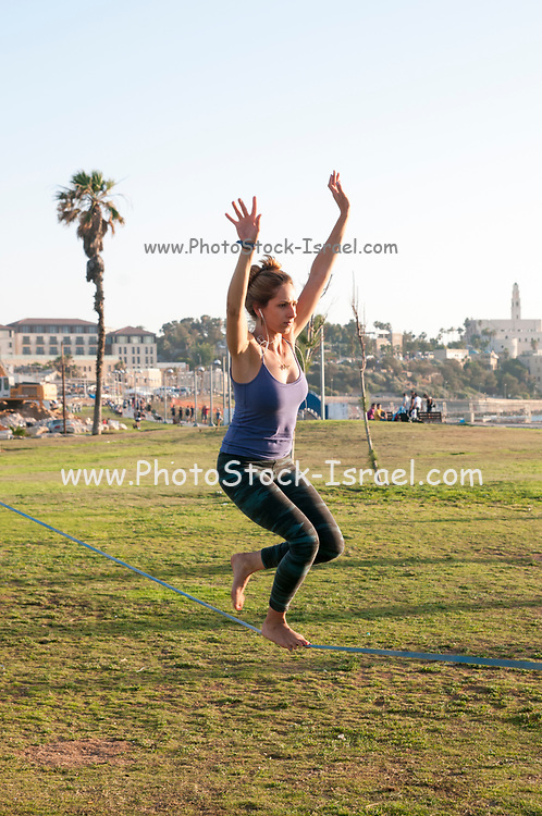 woman Slacklining in Charles Clore park, Tel Aviv-Jaffa with Elinor Cohen. Photography: Ilan Rosen