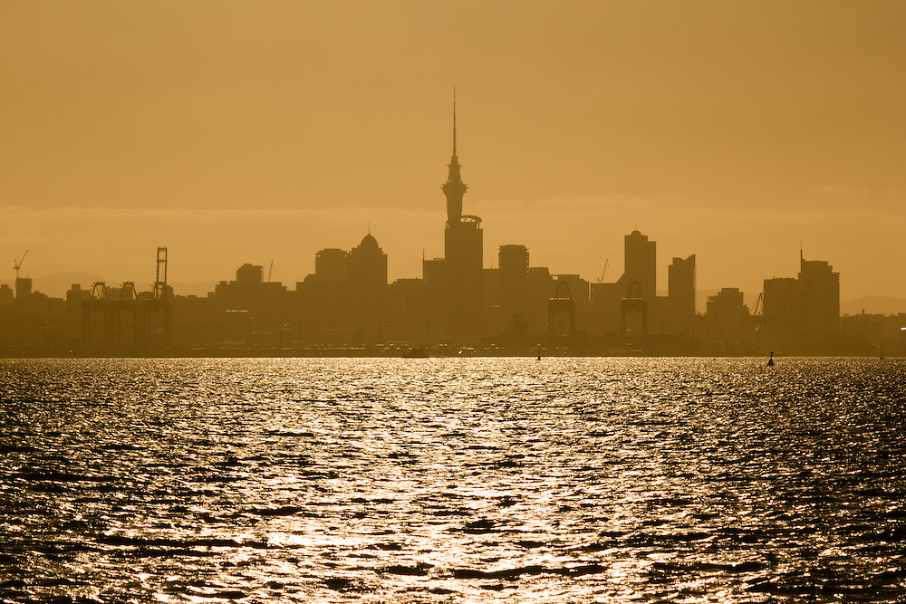 Auckland city from the water, sunset.