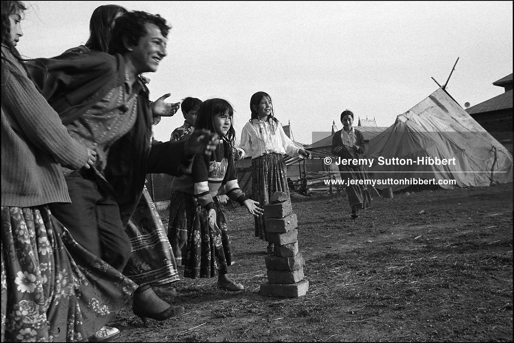 "PLAYING THE BALL GAME ""CASTEL"", (CASTLE). SINTESTI, ROMANIA, MAY 1997..©JEREMY SUTTON-HIBBERT 2000..TEL./FAX. +44-141-649-2912..TEL. +44-7831-138817."