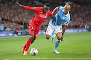 Liverpool forward Divock Origi (27)  and Manchester City defender Vincent Kompany (4)  during the Capital One Cup match between Liverpool and Manchester City at Anfield, Liverpool, England on 28 February 2016. Photo by Simon Davies.