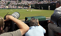 Photographers train there lenses on Maria Sharapova (Russia) Wimbledon Tennis Championship, Day 6, 28/06/2003. Credit: Colorsport / Matthew Impey DIGITAL FILE ONLY