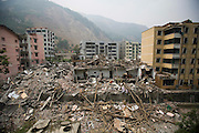 Sichuan earthquake. The Chinese government raised the death toll to 21,500 but has said fatalities could rise above 50,000. Tens of thousands could still be buried in collapsed buildings in Sichuan province, where the quake was centered,