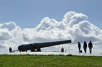 Visitors inspecting 10 inch gun mounted on disappering carriage. Battery Worth, Fort Casey State Park, Washington.