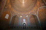 Inside the extravagantly tiled and decorated private mosque: Sheikh Lotfollah Mosque, in Imam Square, Isfahan, Iran. (Imam Square is also called Naghsh-i Jahan Square).