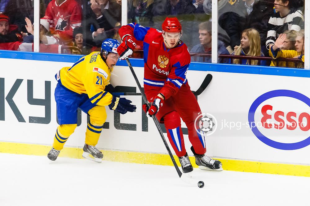 140104 Ishockey, JVM, Semifinal,  Sverige - Ryssland<br /> Icehockey, Junior World Cup, SF, Sweden - Russia.<br /> Filip Sandberg, (SWE), Nikita Tryamkin, (RUS).<br /> Endast f&ouml;r redaktionellt bruk.<br /> Editorial use only.<br /> &copy; Daniel Malmberg/Jkpg sports photo