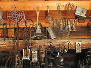 "Kitchen gadgets hang in the late 1800s restored Frontier Ladies Dry Goods Store in Nevada City, Montana, USA. Nevada City was a booming placer gold mining camp from 1863-1876, but quickly declined into a virtual ghost town. This fascinating town inspires you to imagination what life must have been like in early Montana when gold was discovered at nearby Alder Gulch. More than 90 buildings from across Montana have been gathered for preservation at Nevada City, mostly owned by the people of the State of Montana, and managed by the Montana Heritage Commission. In 2001, the excellent PBS television series ""Frontier House"" used one of the buildings and its furnishings to train families in re-creating pioneer life. A miner's court trial and hanging of George Ives in the main street of Nevada City was the catalyst for forming the Vigilantes, a group of citizens famous for taking justice into their own hands in 1863-1864. Directions: go 27 miles southeast of Twin Bridges, Montana on Highway 287."