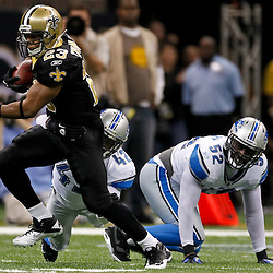 January 7, 2012; New Orleans, LA, USA; New Orleans Saints running back Pierre Thomas (23) escapes a tackle by Detroit Lions safety Amari Spievey (42)  during the 2011 NFC wild card playoff game at the Mercedes-Benz Superdome. Mandatory Credit: Derick E. Hingle-US PRESSWIRE