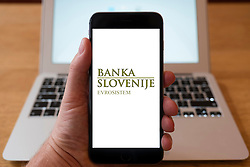 Using iPhone smart phone to display website logo of Bank Slovenije, Bank of Slovenia