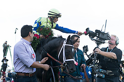 Always Dreaming with John R. Velazquez up gives the NBC camera a close-up with a rose from the garland after winning the 143rd running of the Kentucky Derby at Churchill Downs May 6, 2017.