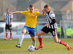Bristol Rovers' Lee Mansell challenges Grimsby's Craig Disley- Photo mandatory by-line: Neil Brookman/JMP - Mobile: 07966 386802 - 14/02/2015 - SPORT - Football - Cleethorpes - Blundell Park - Grimsby Town v Bristol Rovers - Vanarama Football Conference