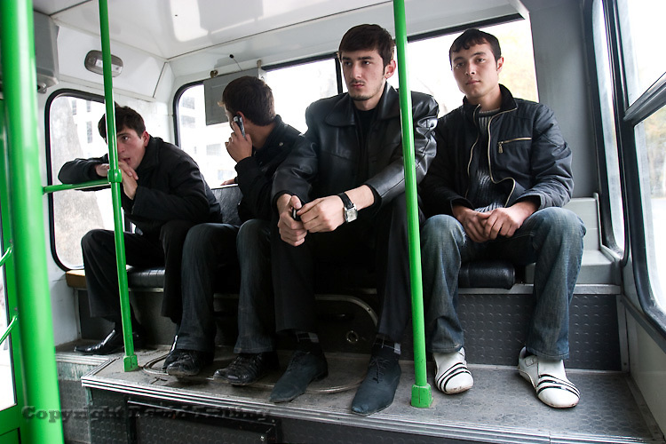 Tajikistan: Youth in the back of a Dushanbe bus. November 2008.