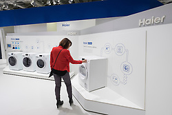Visitor examining washing machines by Haier at 2016  IFA (Internationale Funkausstellung Berlin), Berlin, Germany