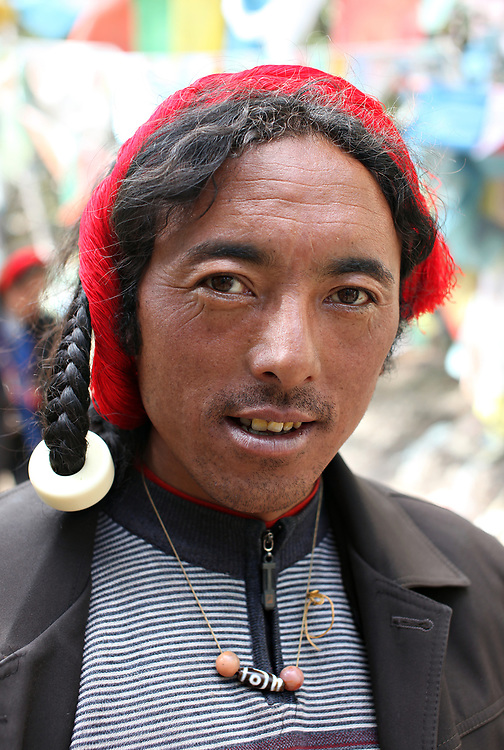 A Tibetan pilgrim stops fro a break during his kora (circumambulation) of Kawagarbo, the third-holiest mountain in Tibetan Buddhism, Yunnan, China; September, 2013.