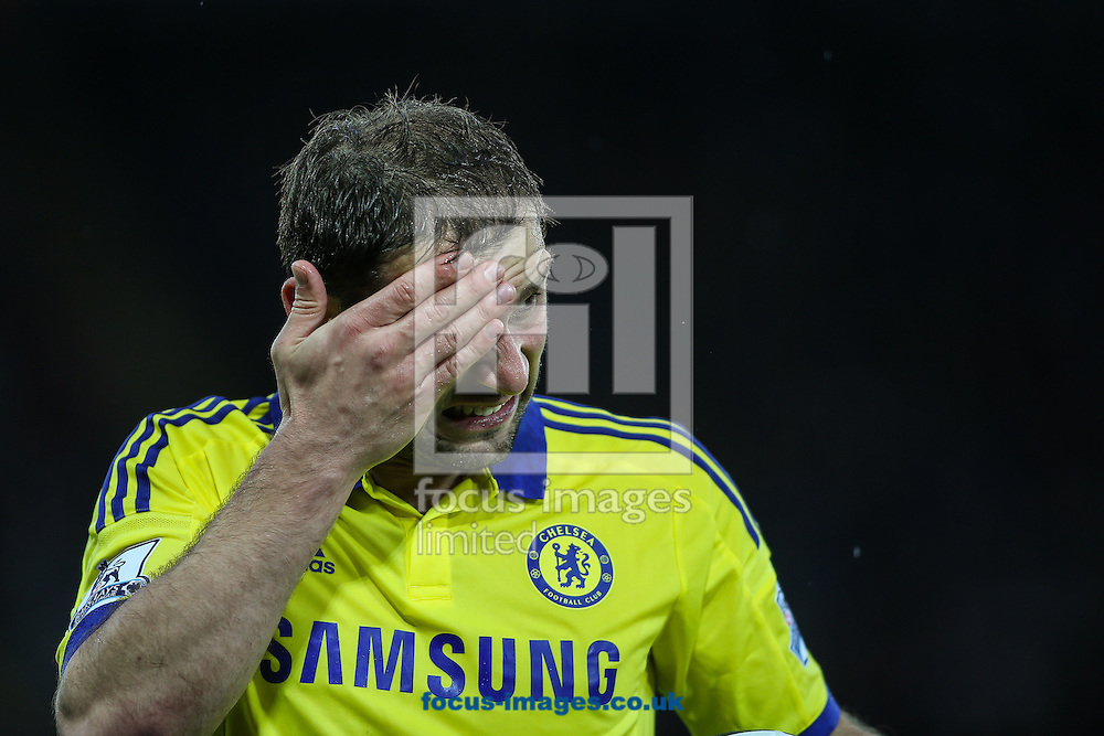 Branislav Ivanovic of Chelsea feels for a cut on his head during the Barclays Premier League match at the King Power Stadium, Leicester<br /> Picture by Andy Kearns/Focus Images Ltd 0781 864 4264<br /> 29/04/2015
