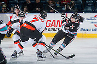 KELOWNA, CANADA - DECEMBER 4: Rourke Chartier #14 of Kelowna Rockets makes a pass against the Medicine Hat Tigers on December 4, 2015 at Prospera Place in Kelowna, British Columbia, Canada.  (Photo by Marissa Baecker/Shoot the Breeze)  *** Local Caption *** Rourke Chartier;