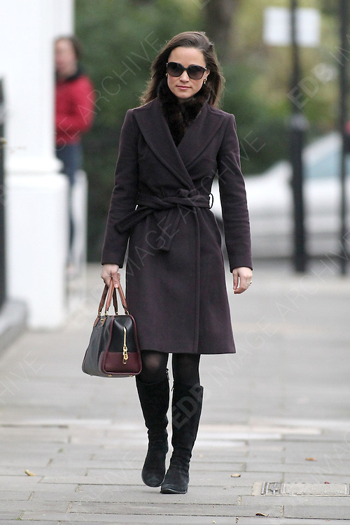 08.DECEMBER.2011. LONDON<br /> <br /> PIPPA MIDDLETON ARRIVES FOR WORK IN LONDON<br /> <br /> BYLINE: EDBIMAGEARCHIVE.COM<br /> <br /> *THIS IMAGE IS STRICTLY FOR UK NEWSPAPERS AND MAGAZINES ONLY*<br /> *FOR WORLD WIDE SALES AND WEB USE PLEASE CONTACT EDBIMAGEARCHIVE - 0208 954 5968*