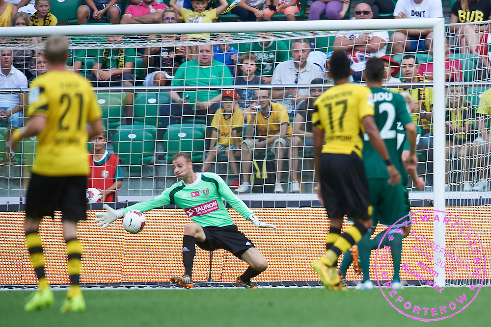 Wojciech Pawlowski goalkeeper of Slask Wroclaw misses the goal during international friendly soccer match between WKS Slask Wroclaw and BVB Borussia Dortmund on Municipal Stadium in Wroclaw, Poland.<br /> <br /> Poland, Wroclaw, August 6, 2014<br /> <br /> Picture also available in RAW (NEF) or TIFF format on special request.<br /> <br /> For editorial use only. Any commercial or promotional use requires permission.<br /> <br /> Mandatory credit:<br /> Photo by &copy; Adam Nurkiewicz / Mediasport