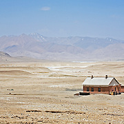 Lone house sits in desolate moonscape of Pamir plateau
