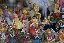 collection of figurines photographed in a store window