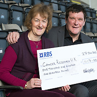St Johnstone Manager Tommy Wright pictured handing over a cheque for £1117.00 to Dorothy Rodger Local Fundarising Manager for Cancer Research UK at McDiarmid Park. The saints gaffer raised the money by having a 'Dry January'<br /> Picture by Graeme Hart.<br /> Copyright Perthshire Picture Agency<br /> Tel: 01738 623350  Mobile: 07990 594431