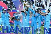 Eoin Morgan of England is sprayed with champaign by Chris Woakes, Liam Plunkett and Tom Curran of England during the trophy presentation celebrations during the ICC Cricket World Cup 2019 Final match between New Zealand and England at Lord's Cricket Ground, St John's Wood, United Kingdom on 14 July 2019.