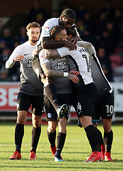 Marcus Maddison of Peterborough United is mobbed by team-mates after putting his side 2-1 up - Mandatory by-line: Joe Dent/JMP - 12/11/2017 - FOOTBALL - Cherry Red Records Stadium - Kingston upon Thames, England - AFC Wimbledon v Peterborough United - Sky Bet League One