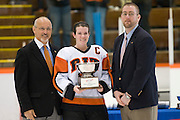 2012/03/04 - RIT captain Kim Schlattman poses with the ECAC West championship trophy after the ECAC West Championship game between RIT and SUNY Plattsburgh at RIT's Ritter Arena on March 4th, 2012. RIT won 2-1 to earn an automatic berth in the NCAA tournament.