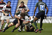 Reading, GREAT BRITAIN, Saracens Shane BYRNE, is caught in the gap, left Richard SKUSE and Robbie RUSSELL during the EDF Energy Cup, rugby match, London Irish vs Saracens at the Madejski  Stadium, ENGLAND, 30/09/2006. [Photo, Peter Spurrier/Intersport-images]..