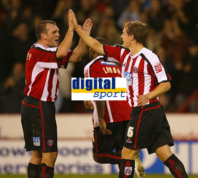 Photo: Aidan Ellis.<br /> Sheffield Utd v Luton Town. Coca Cola Championship.<br /> 01/11/2005.<br /> Sheffield's Phil Jagielka celebrates his goal with Neil Shipperly