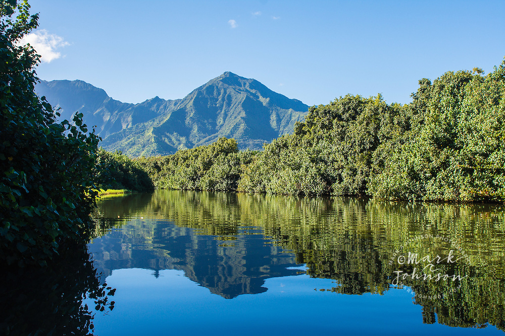 Reflections in the calm and tranquil Hanalei River, Kauai, Hawaii