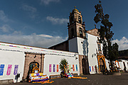 The Templo de Nuestra Señora del Sagrario church with Day of the Dead altars decorated with marigolds in Santa Clara del Cobre, Michoacan, Mexico.