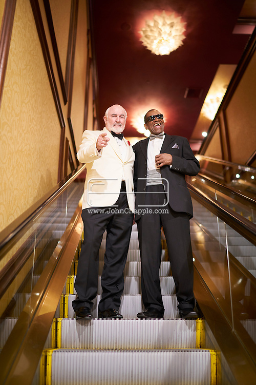 February 22, 2016. Las Vegas, Nevada.  The 22nd Reel Awards and Tribute Artist Convention in Las Vegas. Celebrity lookalikes from all over the world gathered at the Golden Nugget Hotel for the annual event. Pictured is Sean Connery lookalike, Dennis B. Keogh and Ray Charles lookalike, Johnnie Smoot.<br /> Copyright John Chapple / www.JohnChapple.com /