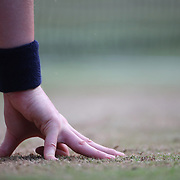 LONDON, ENGLAND - JULY 14: A ball boy crouches near the net ready to retrieve the ball on Center Court during the Wimbledon Lawn Tennis Championships at the All England Lawn Tennis and Croquet Club at Wimbledon on July 14, 2017 in London, England. (Photo by Tim Clayton/Corbis via Getty Images)