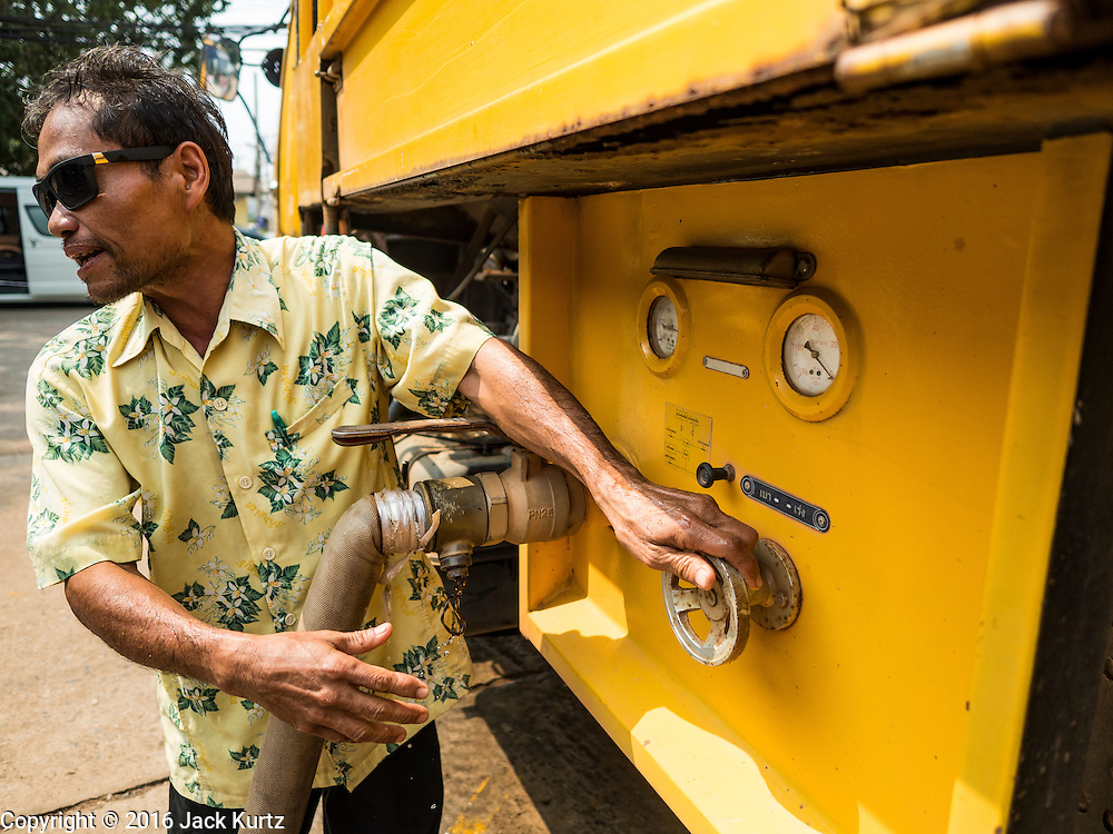 16 MARCH 2016 - PRACHIN BURI, PRACHIN BURI, THAILAND: A worker at Abhaibhubet Hospital in Prachin Buri, shuts down the valve on a water truck after refilling tanks at the hospital. The drought in Thailand is worsening and has spread to 14 provinces in the agricultural heartland of Thailand. Communities along the Bang Pakong River, which flows into the Gulf of Siam, have been especially hard hit since salt water has intruded into domestic water supplies as far upstream as Prachin Buri, about 100 miles from the mouth of the river at the Gulf of Siam. Water is being trucked to hospitals in the area because they can't use the salty water.        PHOTO BY JACK KURTZ